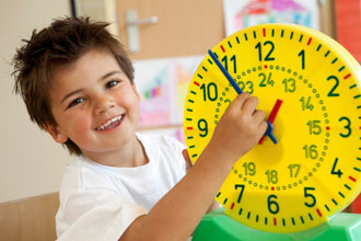 boy learning to tell time