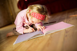 Girl in red bandanna coloring