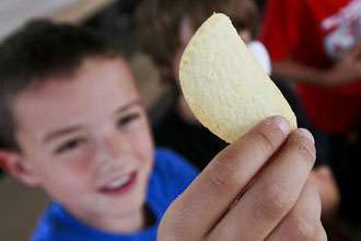 Child holding potato chip
