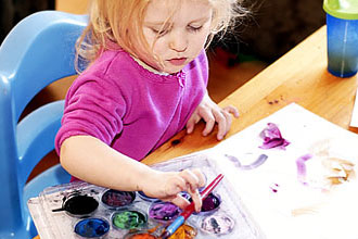 Child with finger paints